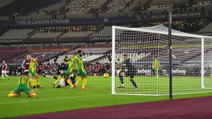 Michail Antonio watches on as his hooked effort beats Sam Johnstone in the West Brom goal