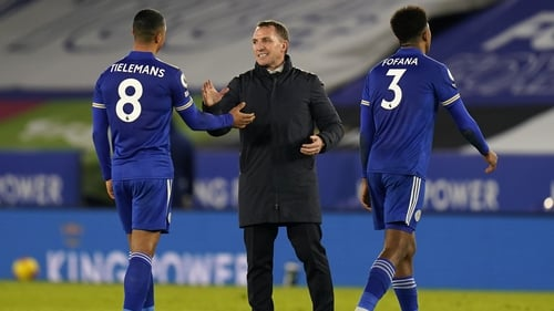 Leicester City manager Brendan Rodgers gestures with Youri Tielemans and Wesley Fofana following the 2-0 defeat of Chelsea