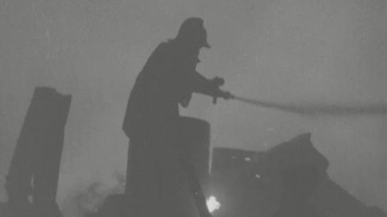 Fireman fighting blaze at Jefferson Smurfit factory, Walkinstown (1971)