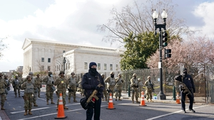 Members of the National Guard and law enforcement gather near the US Capitol