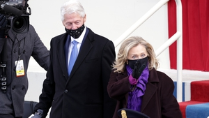 Former President Bill Clinton arrives with former Secretary of State Hillary Clinton