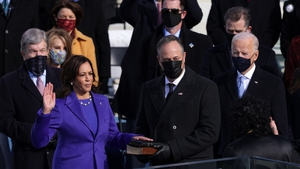 Kamala Harris is sworn in as Vice President as her husband Doug Emhoff looks on