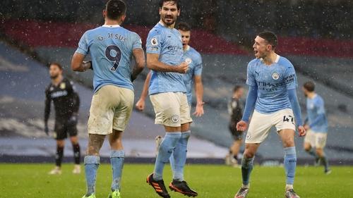 Ilkay Gundogan of Manchester City celebrates his successful penalty