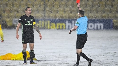 Celtic's Scott Brown (L) is sent off