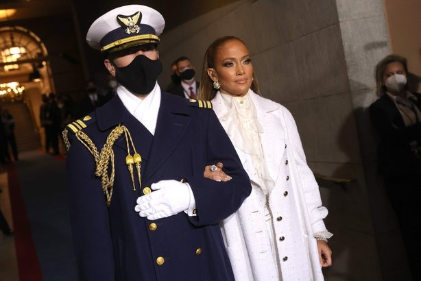 Jennifer Lopez is escorted to the inauguration of US President-elect Joe Biden on the West Front of the US Capitol on January 20, 2021 in Washington DC.