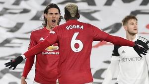 Edinson Cavani celebrates his equaliser against Fulham with Paul Pogba