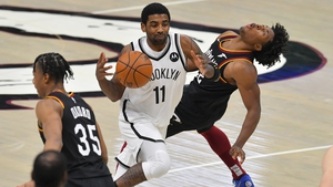 Kyrie Irving of the Brooklyn Nets runs into Cleveland's Collin Sexton