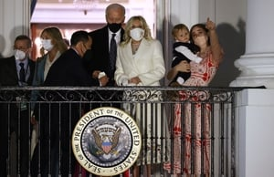 The Biden family watch a fireworks show on the National Mall from the Truman Balcony at the White House