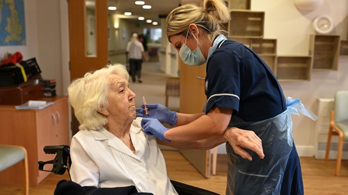 Practice Nurse Victoria Parkinson gives a dose of the Oxford-AstraZeneca vaccine to Ann Wilkinson, 94, at the Belong Wigan care home in Wigan