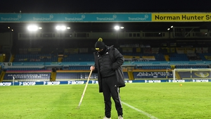A groundsman tends to the Elland Road surface before Brighton game