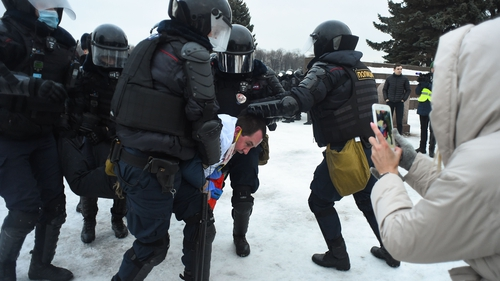 Riot police detain a protester in Saint Petersburg