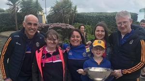 Rebecca Osgood Daly (second from the left) with her family and the Roscommon football manager Anthony Cunningham