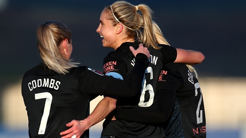 Steph Houghton is mobbed after scoring her second goal