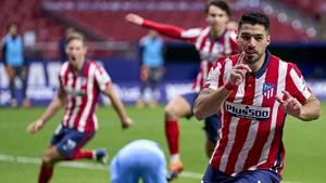 Luis Suarez scored his 12th league goal of the season as Atletico Madrid overhauled Valencia