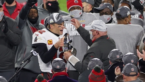 Tom Brady celebrates with Bucs coach Bruce Arians after the road team won the George Halas Trophy