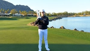 Si Woo Kim of South Korea with the trophy following his victory in California