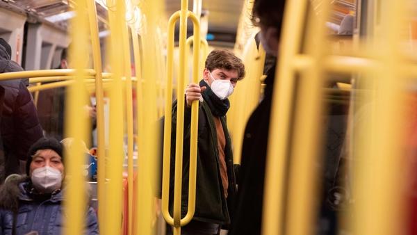 Commuters on an underground train in Vienna are seen wearing FFP2 face masks