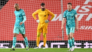 James Milner, Fabinho and Alisson Becker look dejected after Manchester United's first goal