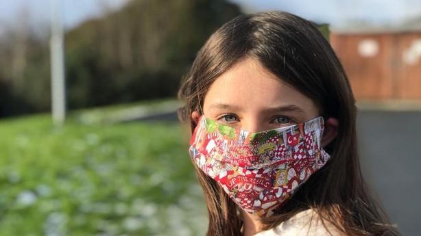 Ella McCarthy wears her Annie West designed face mask
