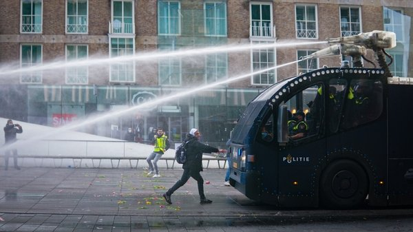 Police in Eindhoven intervene with water cannon during a January protest against the curfew