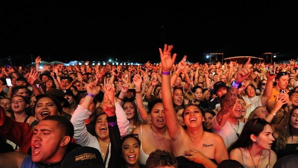 Large crowds enjoy an outdoor concert in Hastings, New Zealand, on Saturday night
