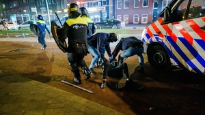 Riot police clashed with groups of protesters in several cities, including here in Rotterdam