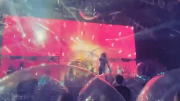 Space man - Flaming Lips frontman Wayne Coyne belts out the tunes in a bubble Photos courtesy: robfromthebeach