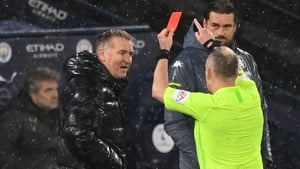 Referee Jonathan Moss (R) red-carded Aston Villa boss Dean Smith for his protestations