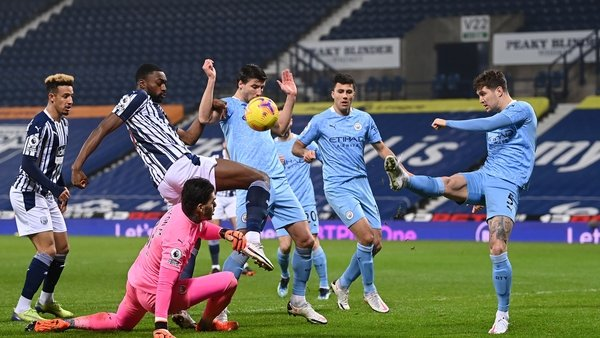 Semi Ajayi of West Brom battles for possession with Ruben Dias, Ederson and John Stones