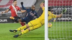 Alexandre Lacazette (C) scores Arsenal's third goal