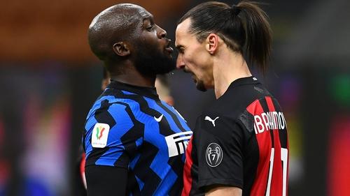 AC Milan's Zlatan Ibrahimovic (R) squares up to Inter's Romelu Lukaku