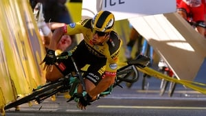 Dylan Groenewegen hits the barrier during his crash in the Tour of Poland