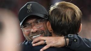 Jurgen Klopp (L) embracing Tuchel during a 2018 Champions League game against PSG