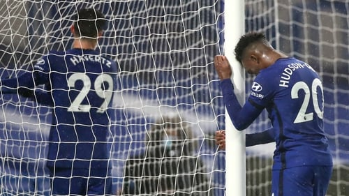 Callum Hudson Odoi leans on the goal post in frustration after a missed chance