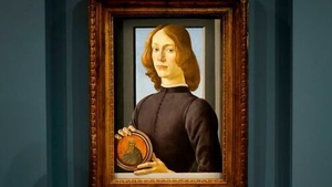 'Young Man Holding a Roundel' shows a man with long golden hair sitting holding a disc featuring a bearded saint