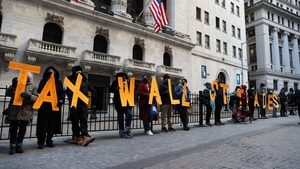 Demonstrators outside the New York Stock Exchange building to protest against Robinhood Market amid GameStop stock chaos