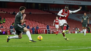 Manchester United defender Harry Maguire(L) blocks a shot from Arsenal's midfielder Nicolas Pepe