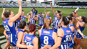 Aileen Gilroy (8) celebrates with her North Melbourne team-mates after the opening-round victory