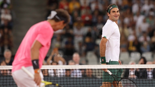 Roger Federer is tied with Rafa Nadal (l) for Grand Slam titles