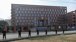 Guards stand outside the Wuhan Institute of Virology