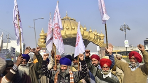 Farmers raising slogans during a protest against the central government's new farm laws, at Golden Gate