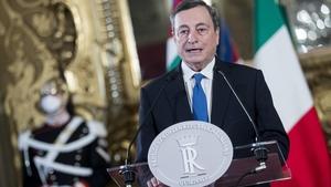 Mario Draghi delivers a speech after talks with Italian President Sergio Mattarella