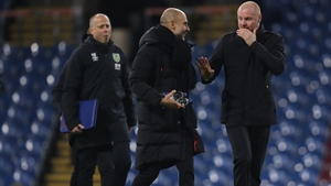 Pep Guardiola and Sean Dyche share a moment after the game at Turf Moor