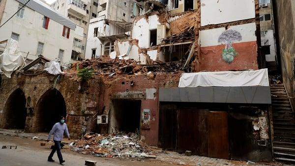 A man walks by a building damaged by the 4 August blast in Beirut's Gemayzeh neighbourhood