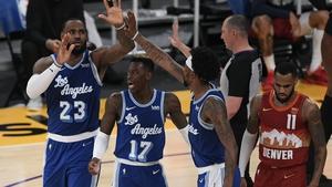 LeBron James celebrates with Dennis Schroder and Kentavious Caldwell-Pope