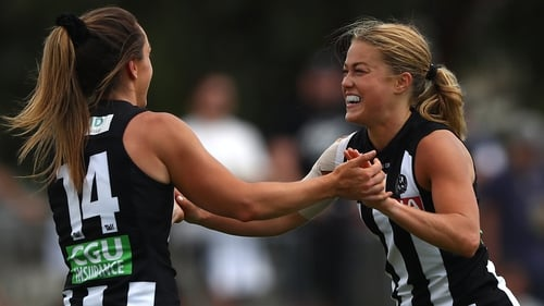 Sarah Rowe (R) celebrates her goal
