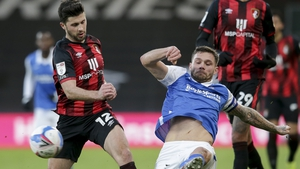 Harlee Dean of Birmingham City challenges Shane Long