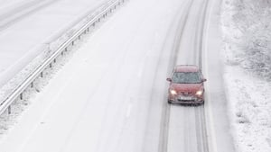 Snow falls on the A14 near Ipswich in Suffolk in the UK today
