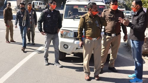 Police in Srinagar of Uttarakhand state after a glacier broke off in Chamoli district causing flash floods