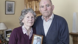 Mary and Denis Walsh Snr with a photo of their son Denis, who went missing in March, 1996